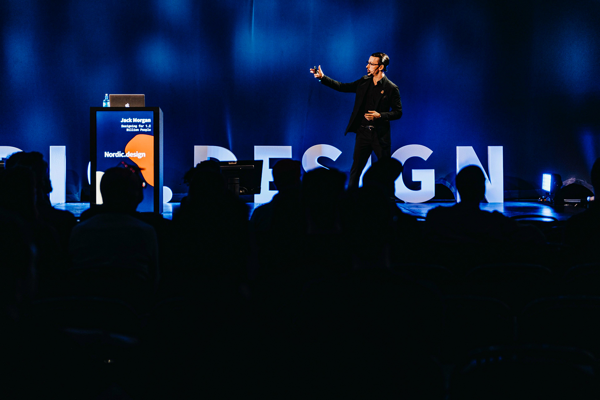 Jack Morgan speaks on-stage in Sweden, 2019